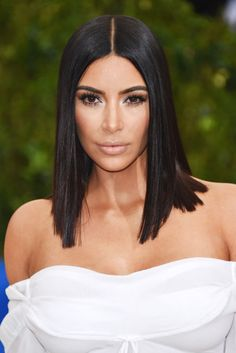 Kim Kardashian's pin straight lob looked shiny and sleek on the Met Gala red carpet.
