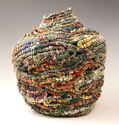 A Woman of Substance basket coiled from discarded silk blouses by Jackie Abrams