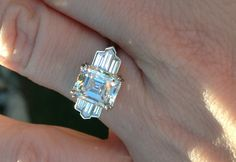art deco emerald cut diamond ring | antique emerald-cut diamond set in a stunning new Art Deco-style ring ...
