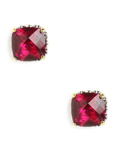 I like the cut and framing but the color I am not nuts for ruby cushion cut studs / baublebar