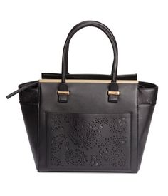 H&M. Handbag in imitation leather with perforated-patterned sections and metal details. Double handles, zip at top, and detachable shoulder strap. Three inner compartments, one with zip. Outer compartment with a perforated pattern. Lined. Size 5 1/4 x 11 1/2 x 11 3/4 in.