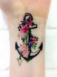 I don't like the anchor, but maybe an arrow? I like the thick black base with all the color around it.