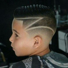 Z Shaped Hard Part On A Faux Hawk With A Medium Fade Mens
