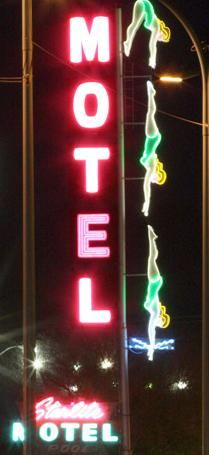 My all-time favorite neon sign. I used to plead with my parents to drive by her at night. Magical!