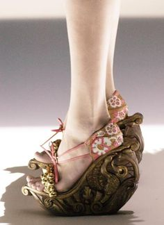 She glides about in the most perplexing shoes, which cause a stir where ever she goes - alexander mcqueen spring/summer 2005