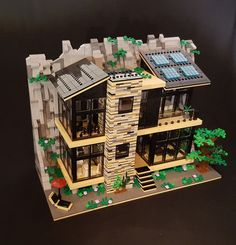 Custom LEGO Green Rock House is a build based on a vision of a sustainable and modern home close to nature. Green Rock House is divided into three parts connected with hinges and technic pins. The roof of each floor can be taken off. The house has full interior with a living room, kitchen, bedroom, music corner, bathroom and gym.