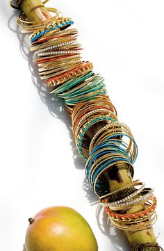 Adding sparkle to every outfit with this mixed media bangle set.