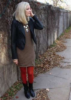 love this winter outfit: stripes, bright tights, and a leather jacket
