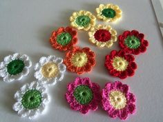 New Set of 36 Assorted Crochet Flowers with 9-Petals. Made with Bamboo and Cotton yarn. These flowers can be used as appliques for all kind of projects.