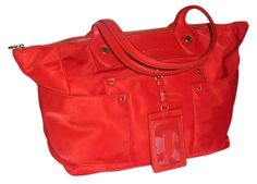 Marc By Marc Jacobs Preppy Nylon East-west Nwt Red Tote Bag. Get one of the hottest styles of the season! The Marc By Marc Jacobs Preppy Nylon East-west Nwt Red Tote Bag is a top 10 member favorite on Tradesy. Save on yours before they're sold out!