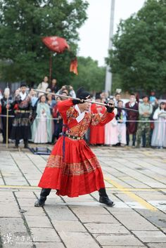 A Chinese man in the royal police uniform of Ming Dynasty --Traditional Chinese Clothing Festival held in West Pond (Xitang), Suzhou