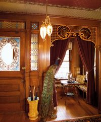 The dominant entry hall deserves special attention with its wainscot or paneling, fireplace, and built-ins. Embossed Lincrusta-Walton wallcovering was popular, as were damask and velour. Patterns were exotic, Japanese or Moorish by way of English interpretation. Dining rooms lightened considerably during the period, but this public room was usually treated in mahogany, cherry, or ebony. (Walnut was by now old-fashioned.)