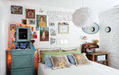 "Casa e Jardim. Really like this eclectic bedroom, especially the pillows & ""gallery"" over bed."