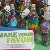 Bottles of skittles and MnM's for wedding favors