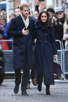 Meghan and Harry done matching blue coats and it's adorable.