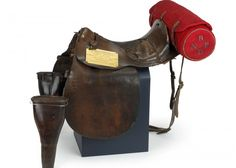 Saddle holed by bullets at Waterloo. Copyright Royal Scots Dragoon Guards Museum.