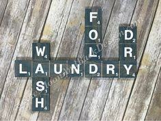Tile Laundry themed wooden sign, made in the style of scrabble game pieces. With the words Wash Fold Dry and Laundry painted on the cut squares. Made from select pine wood to avoid knots in the tiles. These are not individual tiles, and do not need to be hung individually. Boards