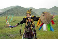 Tamara Shantanova, a female shaman who is almost certainly of the Sakha (Yakut) people, Turkic speakers of northeast Siberia. A modernized cloth costume, including the two circles which used to be worn by male shamans as indicative of breasts but now appear to have become generalized. Thanks to http://www.suppressedhistories.net/