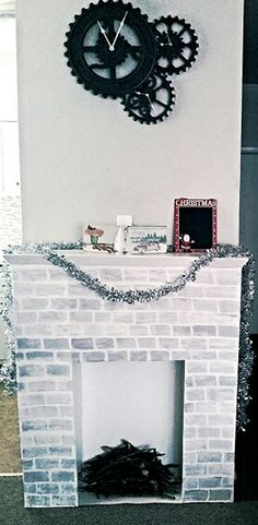 DIY Cardboard Christmas Faux Fireplace made by Cait Makes. https://m.facebook.com/Cait-Makes-698227870320713/