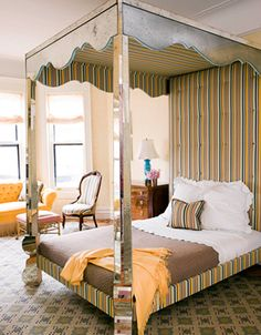 This stunning mirrored four poster canopy bed in this room designed by Jonathan Berger was based on a 1940s Serge Roche bed. I particularly like how Berger mixes the patterns – the geometric rug and stripes are brilliant together!