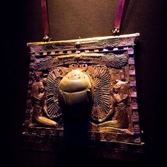Pectoral of Sheshonk II.  Pharaoh Heqakheperre Shoshenq II (887–885 BC) was an Egyptian king of the 22nd dynasty of Egypt. He was the only ruler of this Dynasty whose tomb was not plundered by tomb robbers. His final resting place was discovered within an antechamber of Psusennes I's tomb at Tanis by Pierre Montet in 1939.