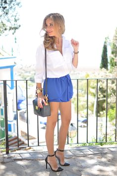 Ellen Vicius  blue bag, blue shorts-skirts, heels and white shirt. Lady and summer look.