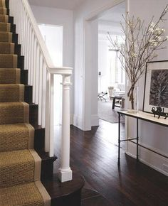I love the look of this house. The dark floors, stair runner, white walls, minimal decor and traditional lay out. My ideal! Entry Stairs, Entrance Foyer, Front Stairs, Entry Hall, Balustrades, Banisters, White Banister, Stair Railing, Stairs