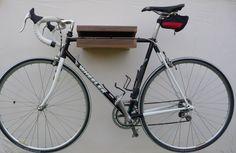 Wooden Bike Rack Walnut, Wooden Bike Shelf, Bike Wall Mount by onTheWall22 on Etsy https://www.etsy.com/listing/211667503/wooden-bike-rack-walnut-wooden-bike