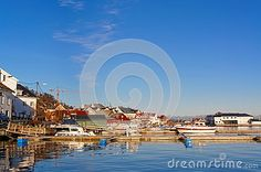 Boats moored next winter secured. In the background, the Norwegian port characteristic buildings. Rocky island with buildings. Boats on the water. Region of southeastern Norway. Winter Scenery, Dusk, Norway, Boats, Buildings, Europe, Stock Photos, Island, Water