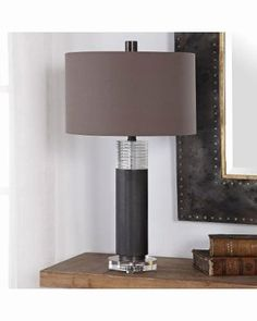 Enhance your space with the modern style of the Ryne Table Lamp by Uttermost. This chic table lamp features a sleek iron cylinder base finished in a plated oxidized bronze topped with a ribbed crystal accent and matching crystal foot. Metal Table Lamps, Table Lamp Sets, Living Room Lighting Design, Living Room End Tables, Contemporary Table Lamps, Modern Table, Buffet Lamps, Home Decor Shops, Accent Furniture