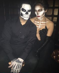 """Jennifer Lopez became a """"couture"""" skeleton while her beau Casper Smart wore a matching look. #refinery29 http://www.refinery29.com/2015/10/96704/best-celebrity-halloween-costumes-2015#slide-12"""