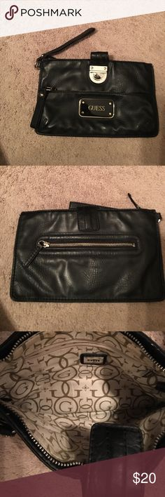 Guess black large wristlet This clutch/wristlet is large and roomy. can fit an iPhone 7 plus, keys, makeup,  hairbrush, etc. it's a nice size and super cute. Bags Clutches & Wristlets