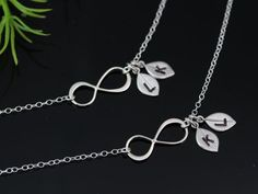 do the boys initials on a chain  or  Mother daughter necklace set  INFINITY Love  Mothers by MonyArt, $58.80