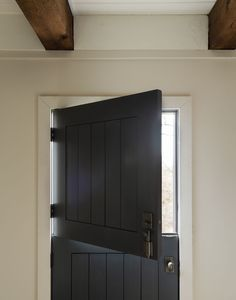 Designed by General Assembly, this architectural gem features a dutch door, and natural beams highlighting the entry. Modern Country, Modern Farmhouse, Countryside Style, English Countryside, Hudson Homes, Timber Beams, Entry Hallway, Vogue Living, Dutch Door