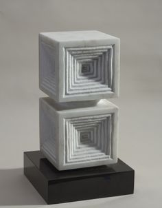 """Abstract sculpture titled """"Eye of the Castle"""" by Japanese artist Minoru Niizuma. White marble mounted on the original black marble base. Signed with an incised K, which is the artist's symbol."""