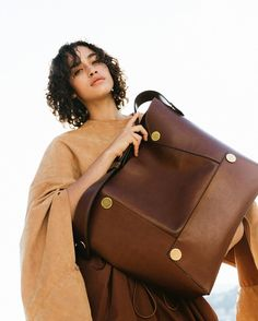 Cruelty-free #StellaPopper bags are made from an eco alter-nappa in a warm cognac tone, fit for a summer of love.     Shop on #StellaMcCartney.com