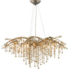 Featuring amber tinted crystal accents and a mystic gold finish, this autumn-inspired chandelier adds natural style to your dining room or entryway....
