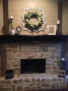 Fixer Upper inspired mantel. Magnolia Wreath from Magnolia Market on top of Hobby Lobby piece.