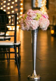 Ceremony Aisle Decor at ARIA in Minneapolis, Minnesota | Petals and Sprigs and Twigs Floral Design contributed to this wedding photo.