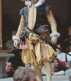 Spectacular costume for Lucio in Measure for Measure (2004). Note the slashed and pinked leather jerkin, peascod doublet, purse and sword furniture.