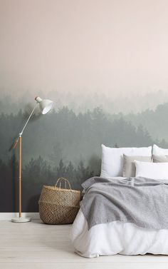 Our Heartwood murals is a peach and green ombre forest wallpaper, featuring a lush landscape of trees that create a calm ombre effect in light to dark cream and sea green shades. Feel the presence of nature in your home with this hazy woods wallpaper, an atmospheric photography piece that looks as though it could have been painted on the wall with watercolors.