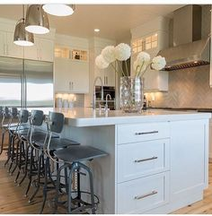 Rocking these industrial style stools from RH in this modern farmhouse kitchen. A favorite ribbon vase from holds flowers from - lights from -📷 by - builder Kitchen Cabinetry, Kitchen Flooring, Wood Flooring, Modern Farmhouse Kitchens, Home Kitchens, Farmhouse Ideas, Classic White Kitchen, Sectional Slipcover, Luxury Interior Design