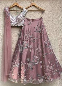 This gorgeous Dust pink hand embroidered Lehenga teamed with Mint green blouse with intricate cutdaana and bead work flaunted with a one of a kind pleated dupatta with appliqué work.Composition: Blouse - Crepe, Lehenga : Tulle with Taffeta Silk u. Anarkali, Half Saree Lehenga, Lehnga Dress, Net Lehenga, Lehenga Blouse, Lengha Choli, Pink Lehenga, Sharara, Jacket Lehenga