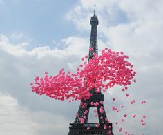 Pink balloons at the Eiffel Tower. (: