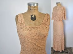 AMAZING lace dress from the 1930's with a matching cape.    Features:  -Delicate lace in a dusty peach color  -Darts at bust and waist  -No