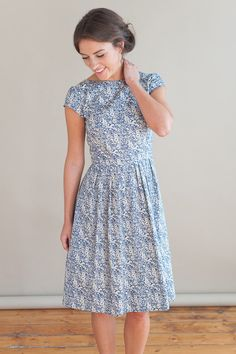 The pretty dress is handmade using a lovely blue and white floral fabric, 100% cotton. The dress has flattering, timeless vintage shape with a fitted bodice, short sleeves and pleated skirt. Concealed zip fastening down the back. All garments are handmade in Manchester and made to