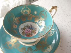 While I have always preferred to sip coffee from pretty fine china, they never make them big enough for my mug-size habit.  Antique Aynsley JA Bailey tea cup set blue tea by ShoponSherman, $119.00