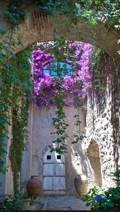Arch of flowers at Castello Aragonese in Ischia, Italy