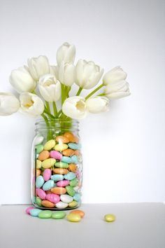 We love the use of jordan almonds in a Spring flower arrangement. What we love even more? This #DIY #hack shows you how to use 'em, without getting them soggy!