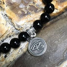 ~ Did you know? The Eye of Horus is actually an ancient symbol of protection, royal power and good health? Our #new Men's Ancient Royal Bracelet features gorgeous AA grade Black Onyx gemstones with an antique Tibetan silver reversible Eye of Horus charm to offer fierce protection, energy and strength during times of stress and fatigue. 🌀🙏✨ #destress #blackonyx #eyeofhorus #ancientwisdom #royal #mensjewelry #mensfashion #mensstyle #mensbracelet #healingjewelry #relaxation #protection…